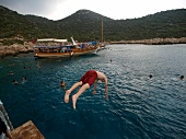 Man jumping into water in Kas, Lycia, Antalya, Turkey