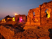 Ruined walls with evening lights at sunset