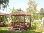 Gazebo decorated with curtains in garden