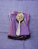 A spoonful of buckwheat on a purple napkin