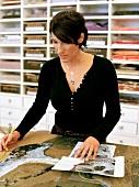 Mosaic artist Nicloe Zach working in her office
