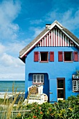 Graswarder blue house at beach, Baltic Sea Coast