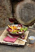 An autumnal salad made with radicchio, pumpkin, grapes and red onions
