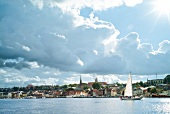 View of Flensburg shore boats with cloudy sky, Baltic Sea coast