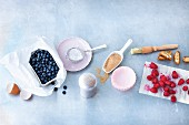 An arrangement of ingredients for berry muffins