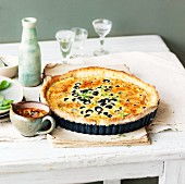 Cheese tart with Parmesan and olives