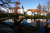 Reflection of white mansion facade in water, Gelting , Germany