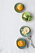 Four different vegetarian flans (seen from above)