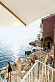 People at Valentino bar, Rovinj rocky coastline, Croatia