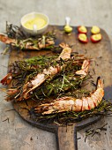 Prawns wrapped with rosemary, and tomatoes with saffron mayonnaise