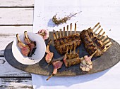 Marinated rack of lamb on platter, overhead view