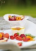 Grilled fruits on yogurt glass