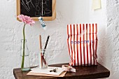 Homemade popcorn in a striped paper bag as a gift