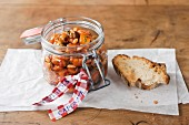 A jar of Caponata Siciliana with bread as a gift
