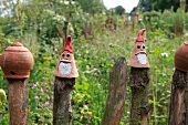 Clay pots on wooden post in garden at Baltic coast, Schleswig-Holstein