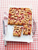 Tray bake crumble cake with strawberries and rhubarb