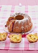 An almond Bundt cake with cherries and mirabelle tartlets