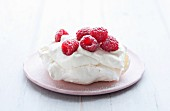 A meringue tartlet with raspberries