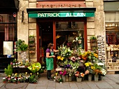 Woman at flower shop in Ile Saint-Louis, Paris, France