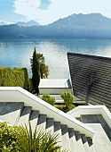View of Alps, Lake Lucerne and lake house at Weggis, Lucerne, Switzerland