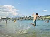 People enjoying and jumping at Ufschotti at Lucerne, Switzerland