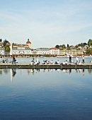 Cityscape of Lucerne and people sitting on jetty, Lake Lucerne, Switzerland