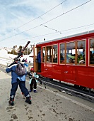 People in train on Vitznau Rigi Railway, Mount Rigi, Alps, Lucerne, Switzerland