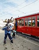 People in train on Vitznau Rigi Railway, Mount Rigi, Alps, Lucerne, Switzerland