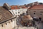 Tourists around Onofrio Fountain in Dubrovnik, Croatia