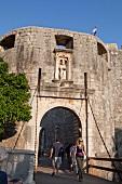 People in Pile Gate western city wall, Dubrovnik, Croatia