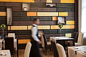 Waiter walking in Zagreb Restaurant, Croatia, blurred motion