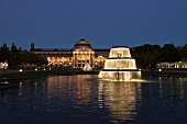 Facade of illuminated Kurhaus and fountain at Wiesbaden, Hesse, Germany