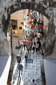Tourists at iron gate in Split, Croatia