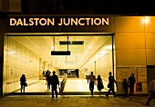 Rear view of people in Dalston Junction Station, London, UK