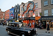 Black taxi cab on High Street, Camden Town, London, UK