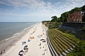 Tourists relaxing on beach of Trzesacz in Poland