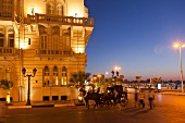 Horse carriage in front of Hotel Cecil Sofitel at dusk, Alexandria, Egypt