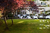 Tables laid in patio of Brenners Park-Hotel and Spa, Baden-Baden, Germany