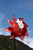 Close-up of wind turbine with the Swiss cross, Ticino, Switzerland