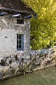 House on the river Loue in Ornans, Franche-Comte