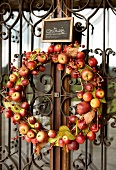 Apple wreath at the entrance gate of Granary hotel, Franche-Comte