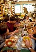 Family having food in Restaurant Les 4 heures du cremier in Arbois, Franche-Comte, France