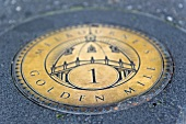 Close-up of Golden Mile plaque on ground in Melbourne, Victoria, Australia