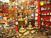 Different antique gold plated vessels at display, Istanbul Grand Bazaar, Istanbul, Turkey