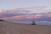 View of sunset with sky, clouds and car, Fraser Island, Queensland, Australia