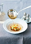 Potato consomme with trout caviar