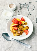Fried caramel potatoes with strawberries and nectarines