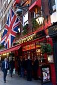 British man drinking Feierabendbier at The Globe Pub in Aldwych, London