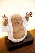 Close-up of Asian Chinese Buddha Figure on table
