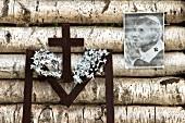 Photo of Pope John Paul II and Crucifix on pile of woods, Mikolajki, Poland